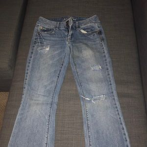 Pair of medium washed artist jeans